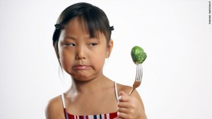 Girl-Eating-Brussels-Sprouts